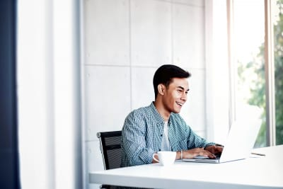 businessman working on computer laptop in office. sitting on desk
