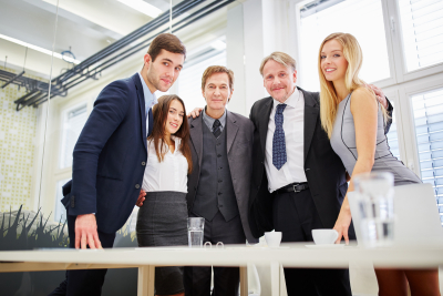 Competent business team proud of their teamwork